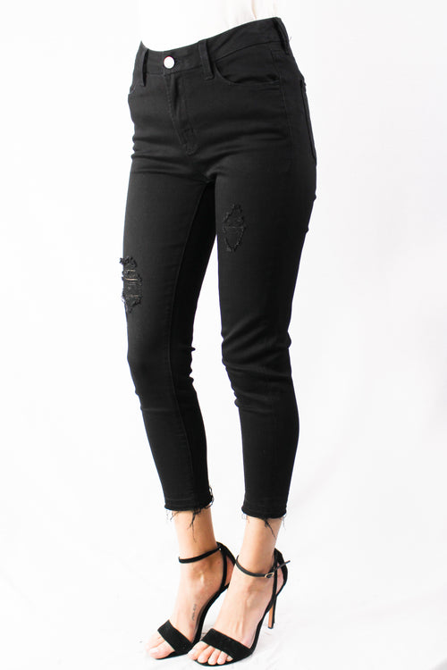 black skinny distressed jeans.