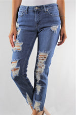 Ultra Distressed Straight Cut Jeans with Destroyed Hem