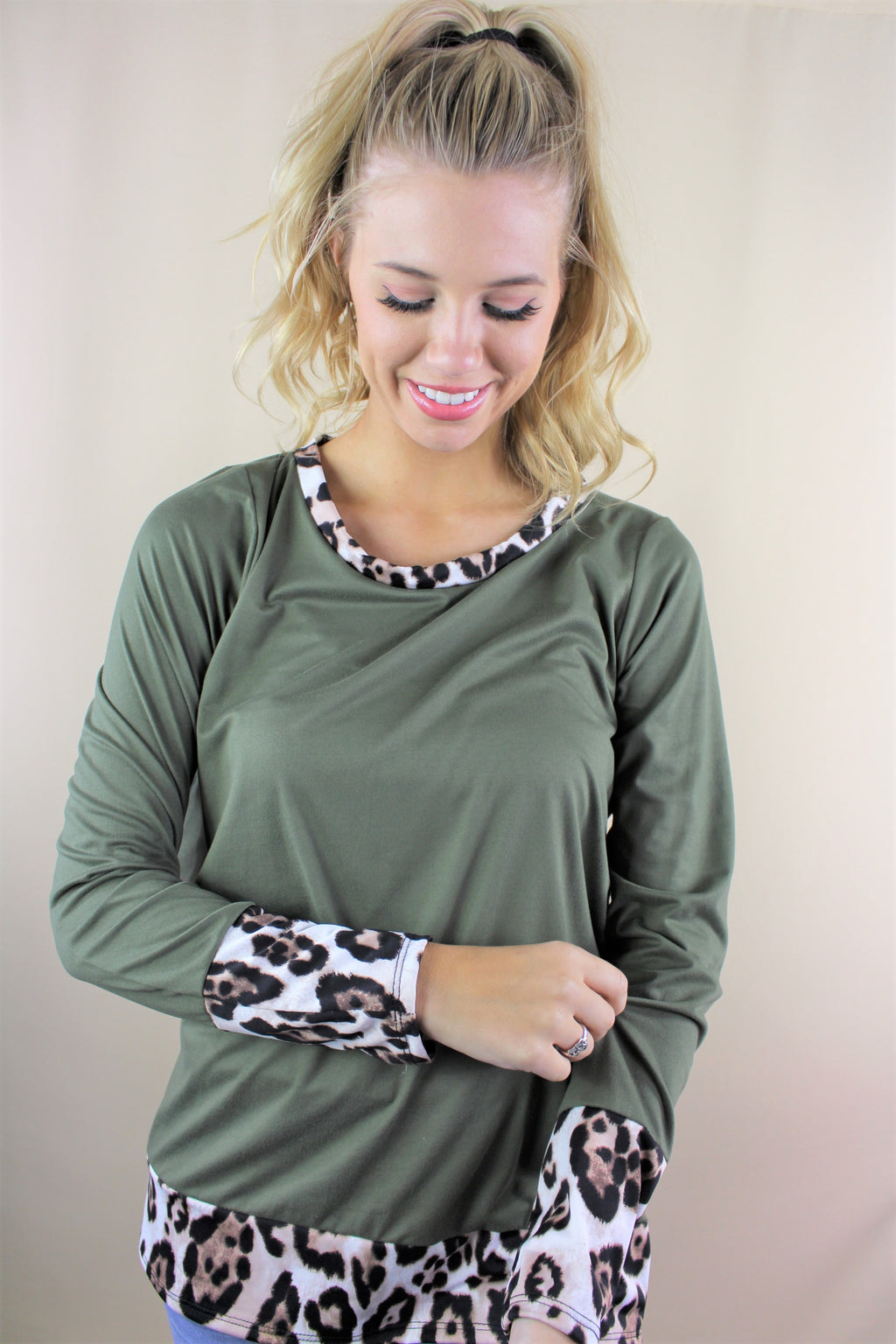 Women's Long Sleeve Solid Top with Animal Print Hem