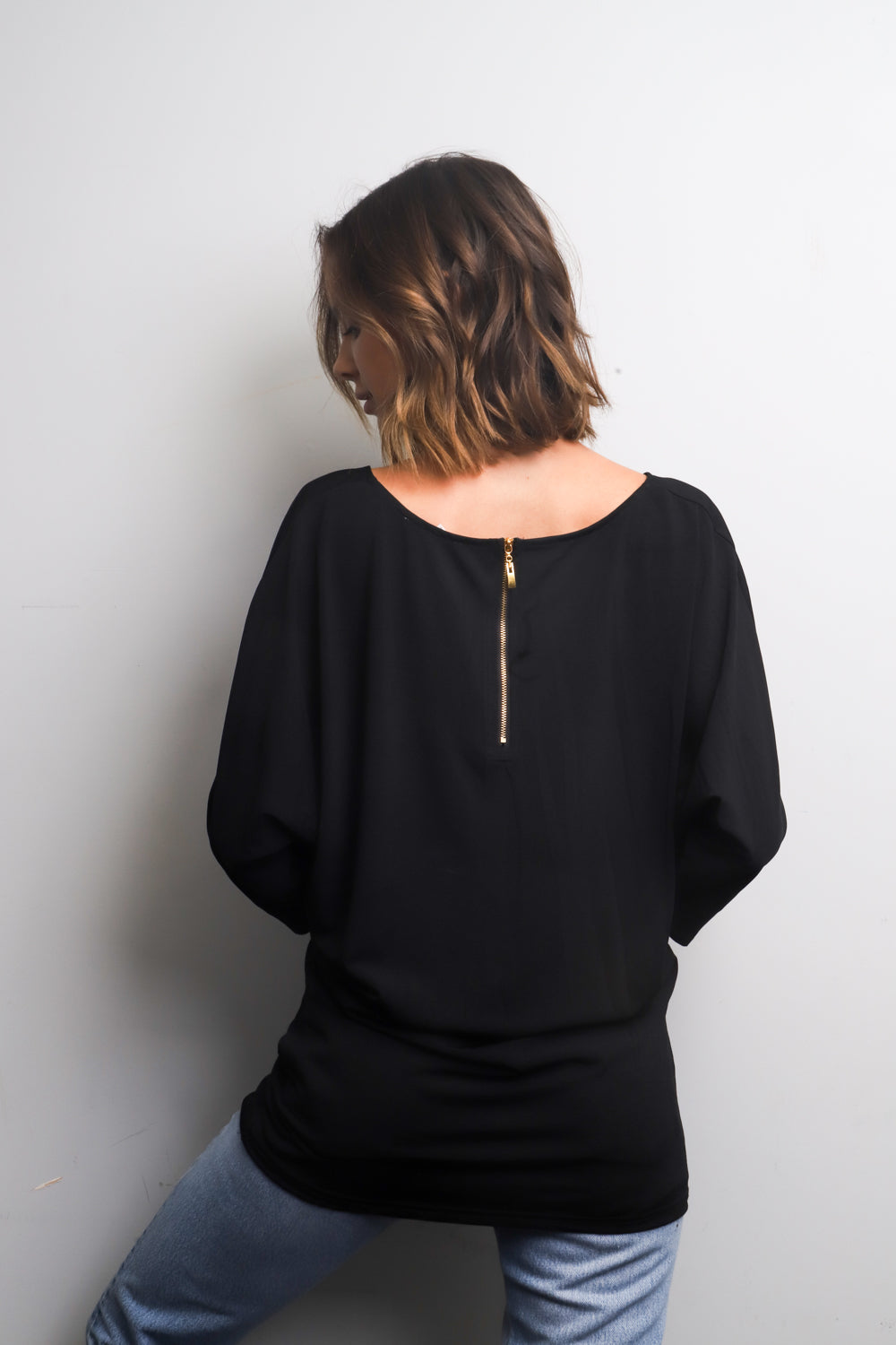 Black 3/4 sleeve top w/ zipper detail back
