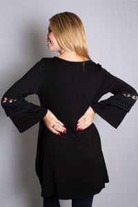 long sleeve black top with crochet details along the neckline