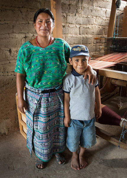 Mayan Hands weaver Juliana Lajuj and son by her loom
