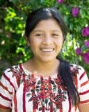 maria mayan hands scholarship recipient