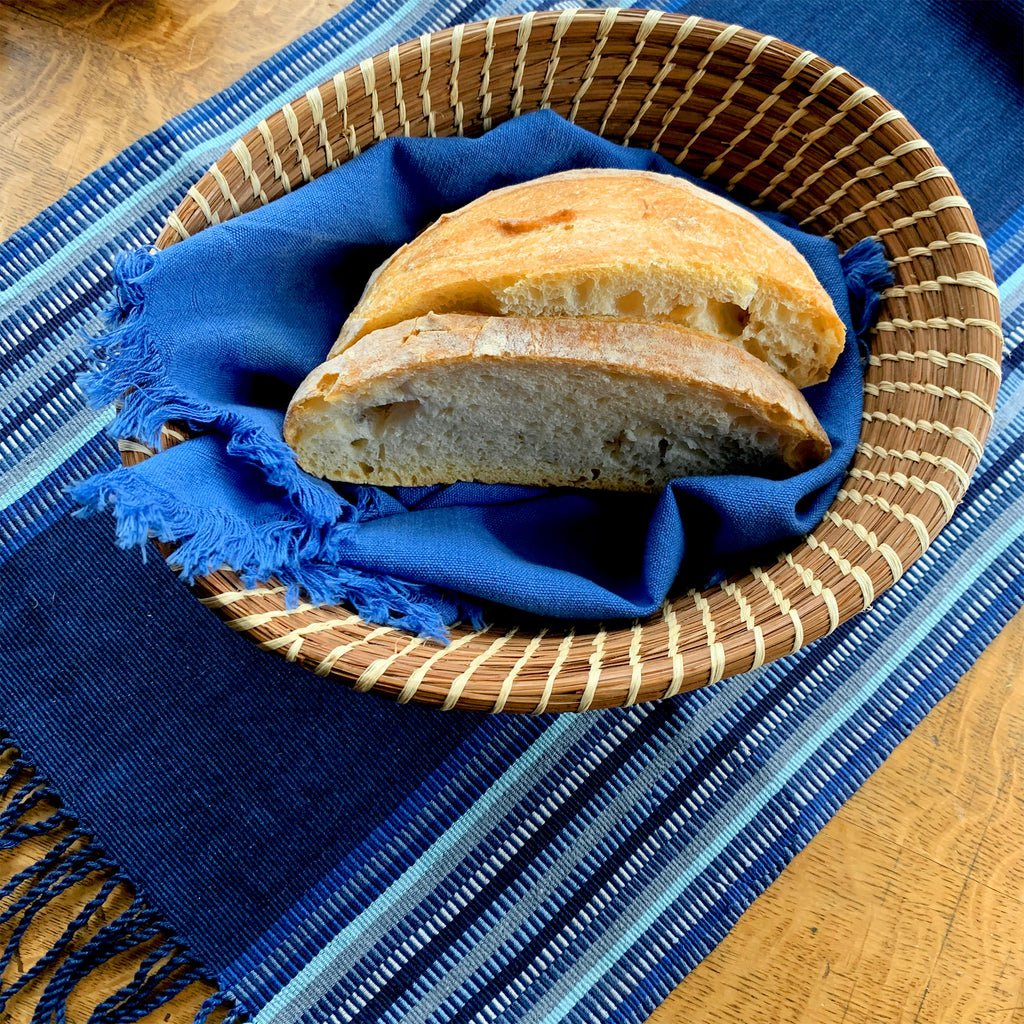 homemade bread with Mayan Hands basket and table linens