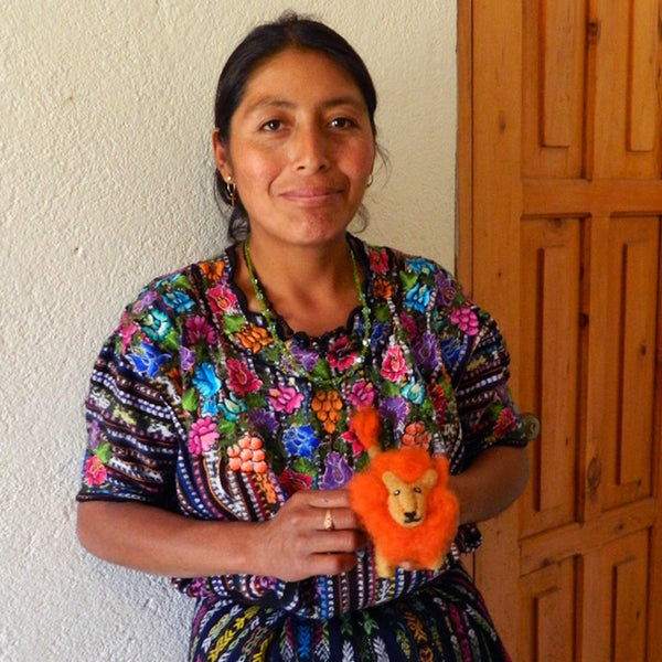 Mayan Hands artisan with needle felted animal