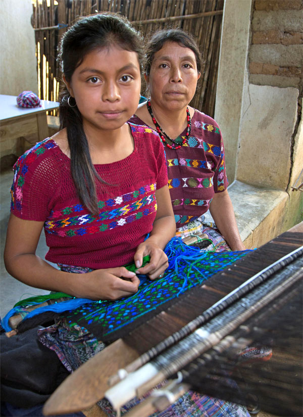 mother-teaching-daughter-to-weave-backstrap