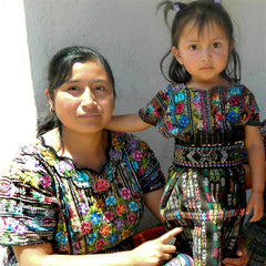 mother and daughter wearing huipiles