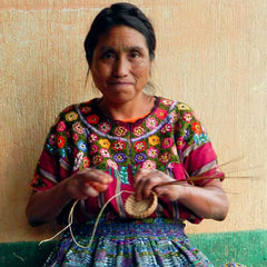 Mayan Hands basket maker wearing huipil