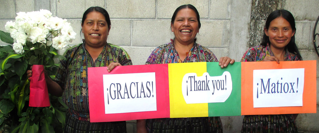 Mayan Hands artisan partners with thank you signs