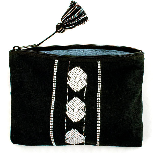 black an white brocade cosmetic clutch with tassel and recycled denim lining