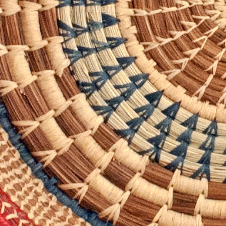 detail of large checkered pine needle basket