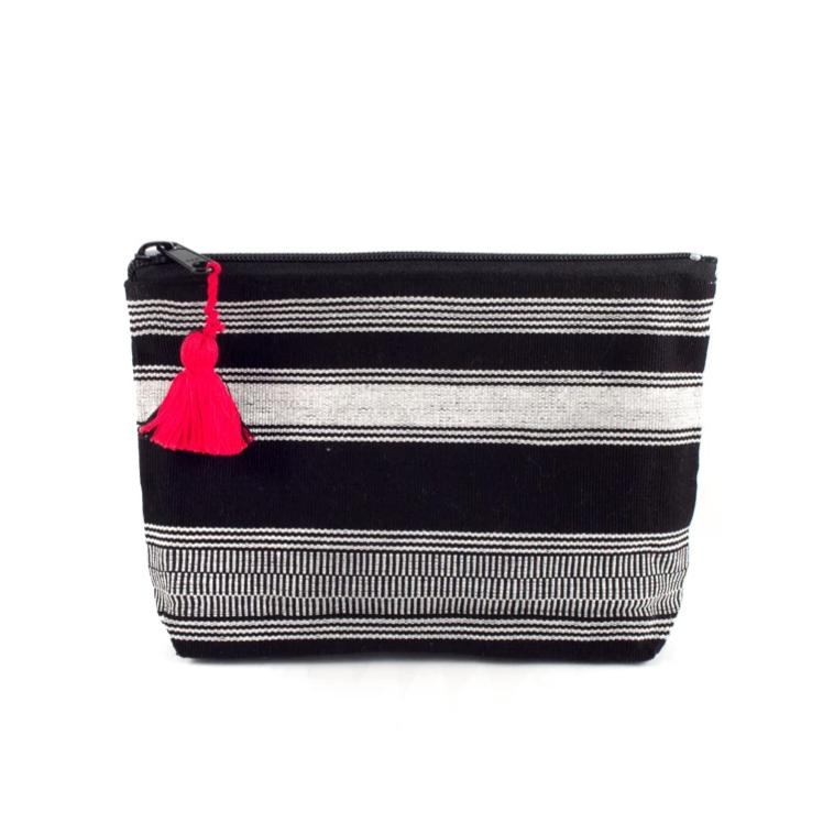 black and white cosmetic bag with red tassel