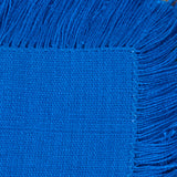 medium blue handwoven napkin with fringe detail