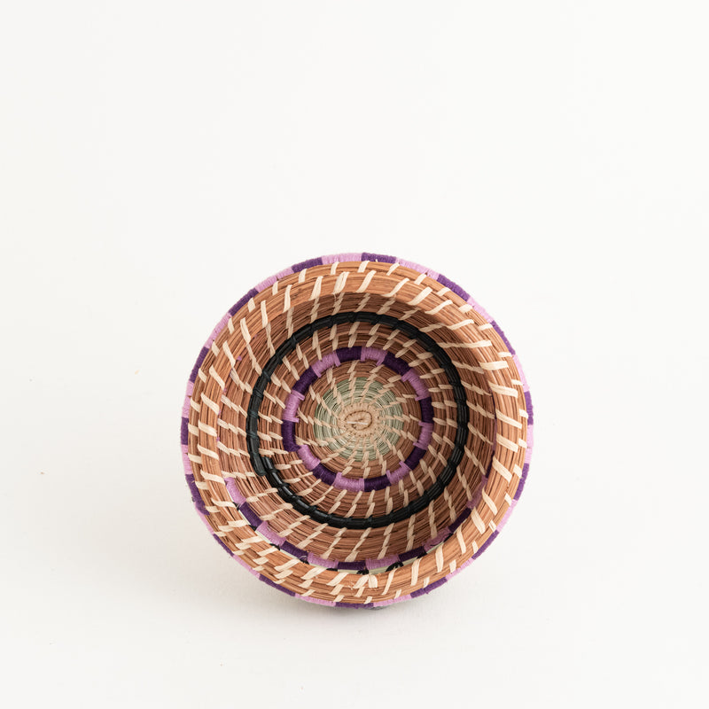 small pine needle basket with colorful thread top view