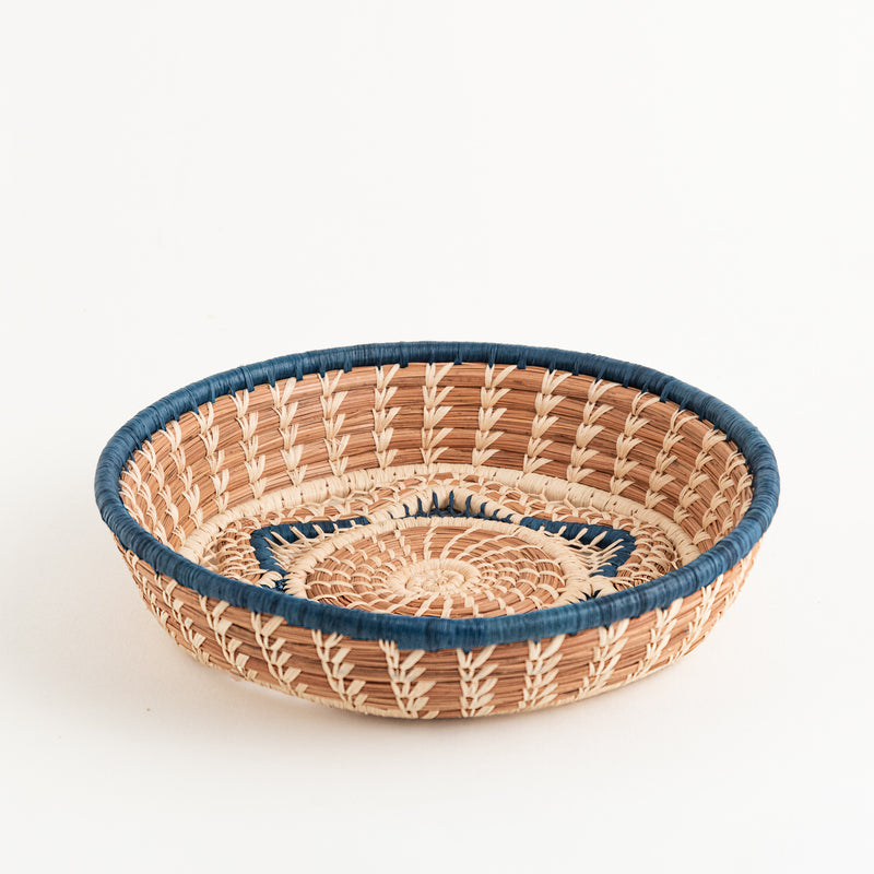 pine needle basket with star center and blue trim side