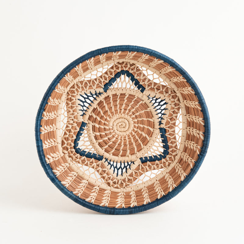 pine needle basket with star center and blue trim