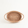 oval pine needle basket with handles, showing top view and intricate stitches