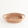 oval pine needle basket with handles, 3/4 view