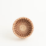 small round pine needle basket with straight sides looking down