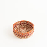 Small straight-sided pine needle basket with orange accent