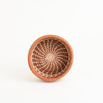 Small straight-sided pine needle basket with orange accent top view