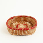 pine needle basket with red and brown accents