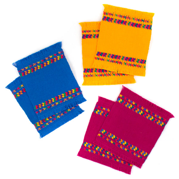 assorted colorful cotton coasters with brocade border