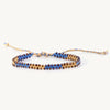 centipede friendship bracelet with beads along edges