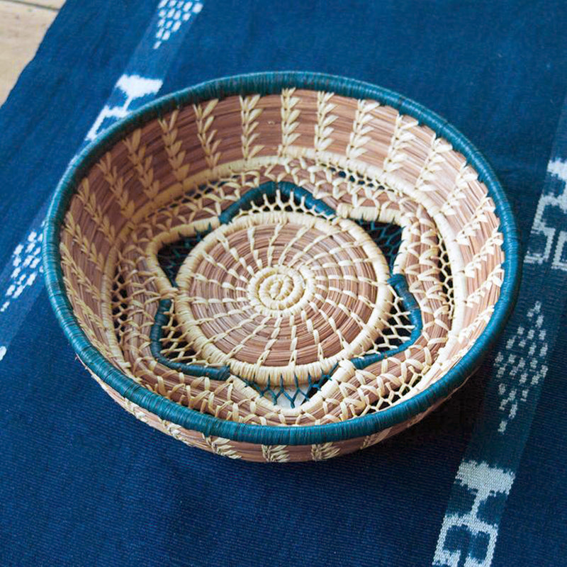 pine needle basket with blue star accent on table runner