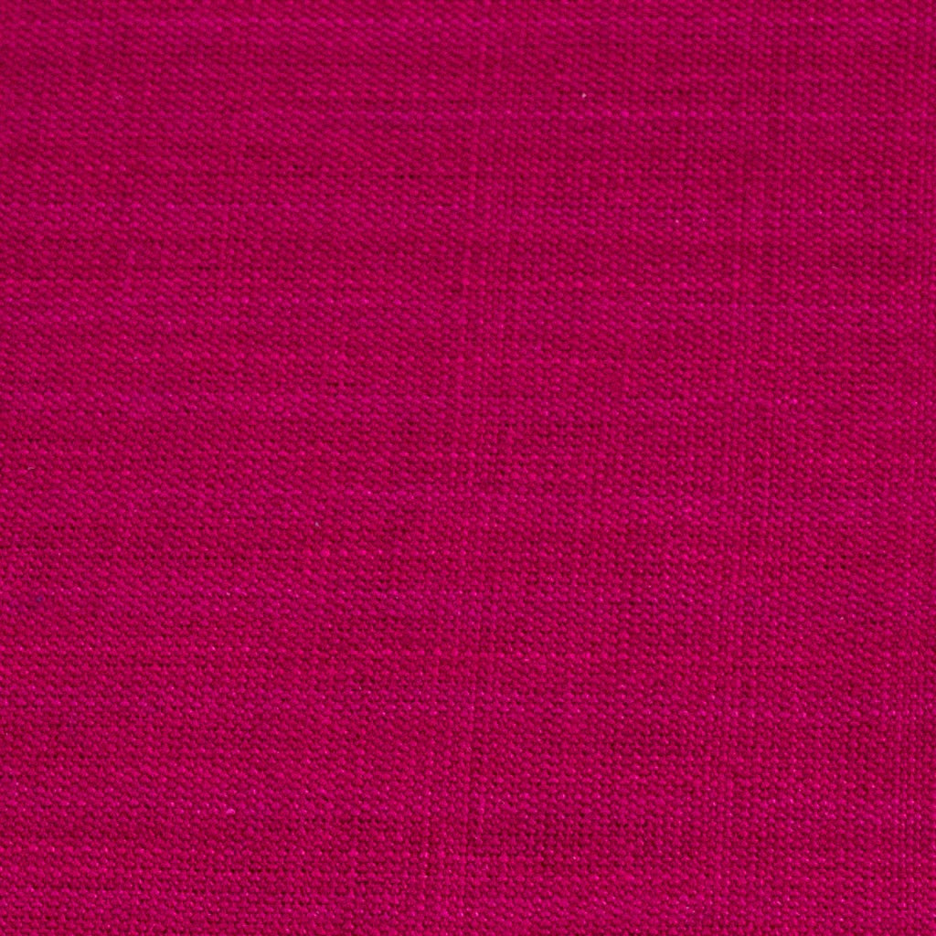magenta handwoven napkin with fringe detail