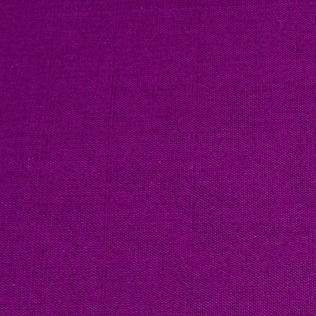 dark purple handwoven napkin with fringe detail