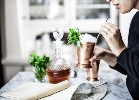 bourbon mint julep in a copper julep cup by standard spoon barware at the cocktail ritual blog