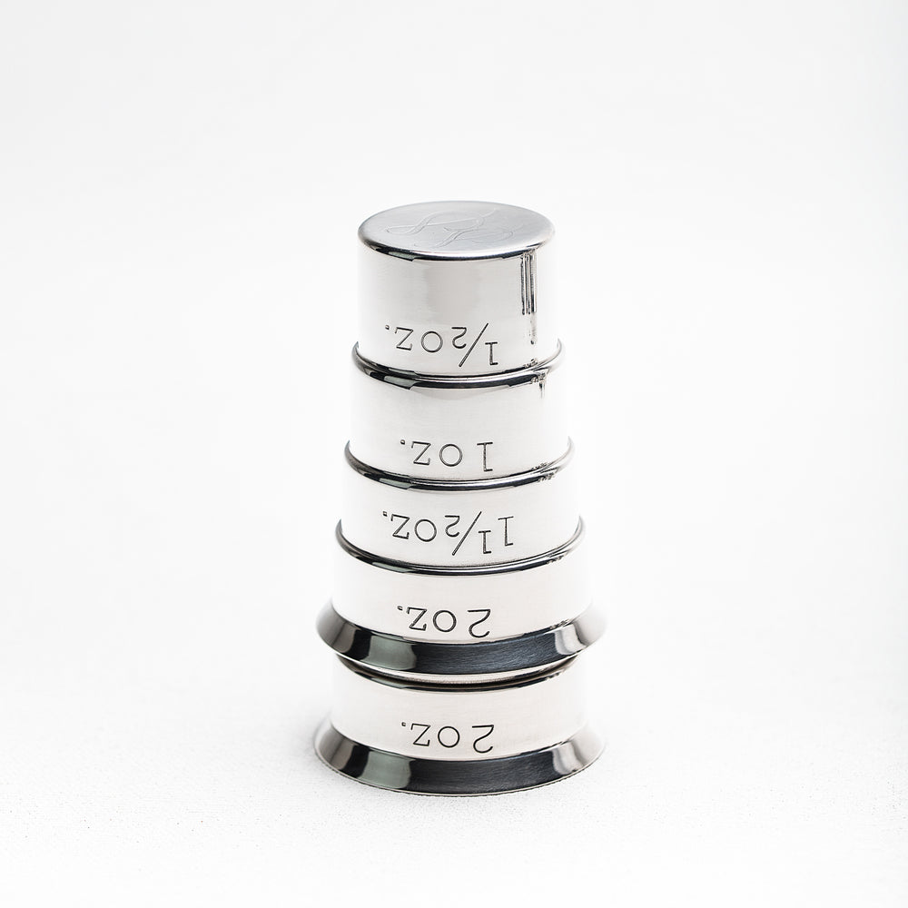 Stainless Steel single-piece unbreakable stepped cocktail jigger. Both OZ and ML Measurements available. Lifetime Guarantee. The Industry Napier Jigger by Standard Spoon