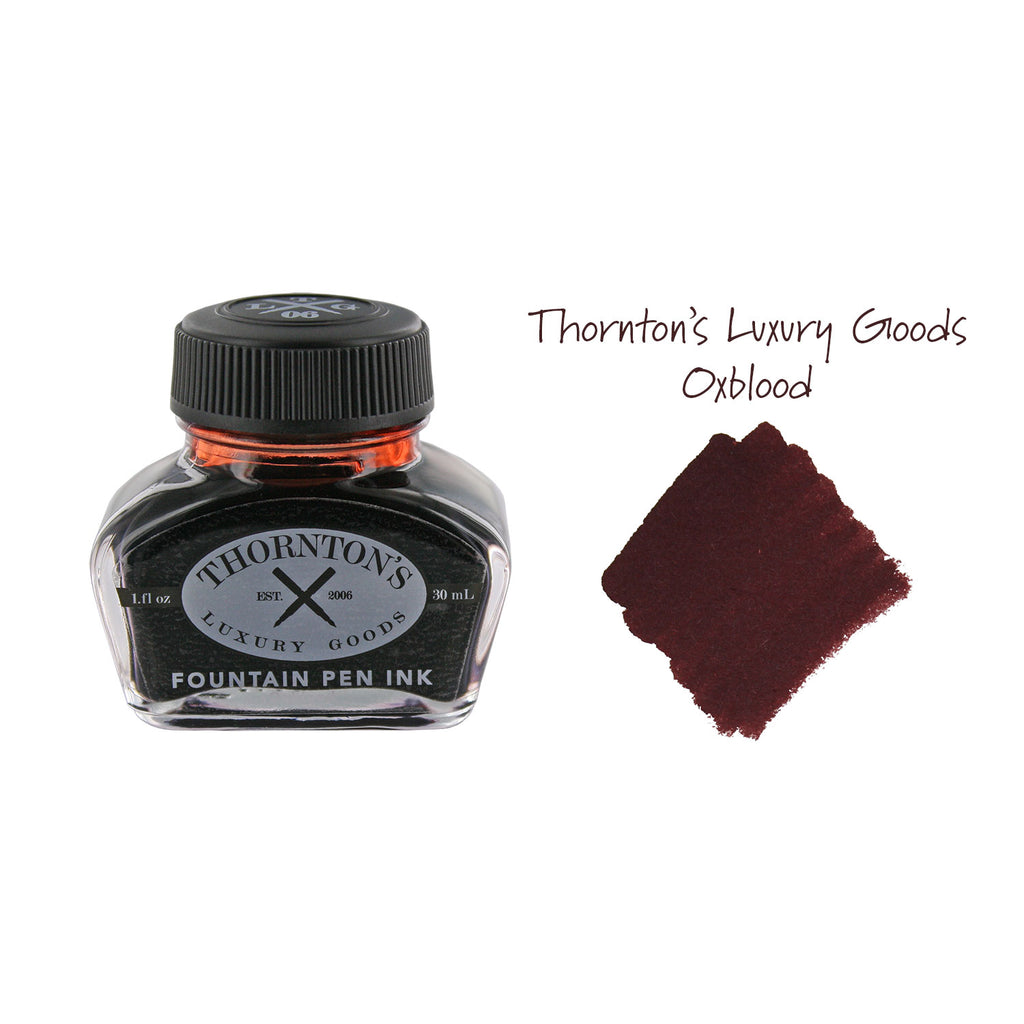 Thornton's Luxury Goods Oxblood Fountain Pen Bottled Ink next to an ink swab of the Oxblood ink.