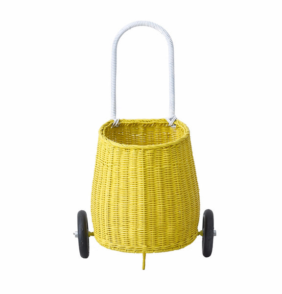 Two wheeled pull along storage basket by Olli Ella in yellow.