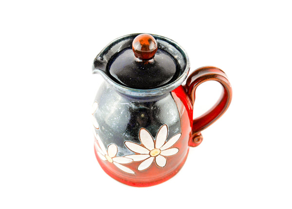 Pottery Creamer with lid and daisy decoration top view