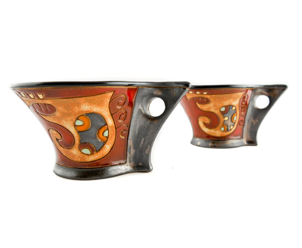 Two espresso cups with different hand painted shapes