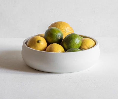 Large flat nesting bowl with lemons and limes