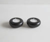 pair of black granite tea light holders with unlit candles