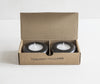 Pair of black granite tea light holders in box