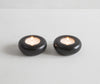 Pair of simple tea light holders in black granite