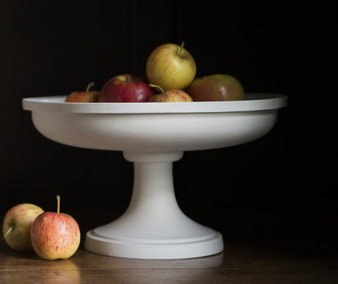Tall porcelain fruit stand with fruit