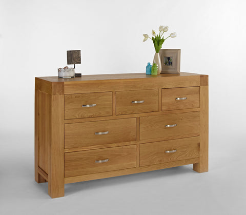 Low wide oak chest of drawers