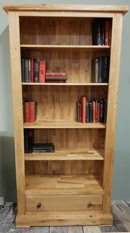 Tall solid oak bookcase with drawer
