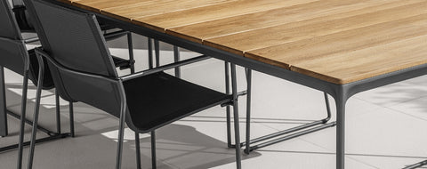 Brushed aluminium table frame with teak top