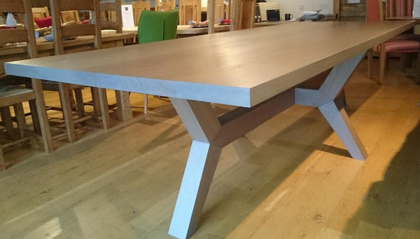 Contemporary angled oak dining table showroom