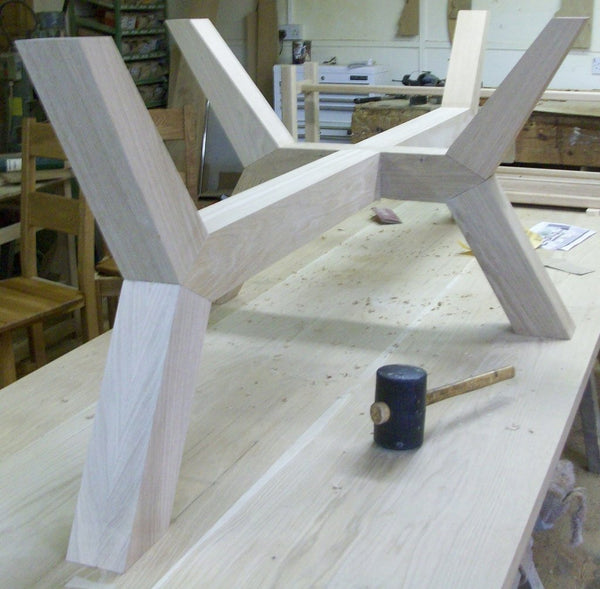 Contemporary angled oak dining table base in workshop