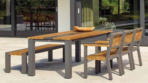 Contemporary designed outdoor table in teak and aluminium