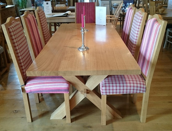 Cross leg table with a set of Swailes chairs