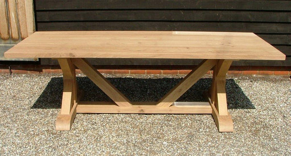 Cross braced oak dining table outdoor shot